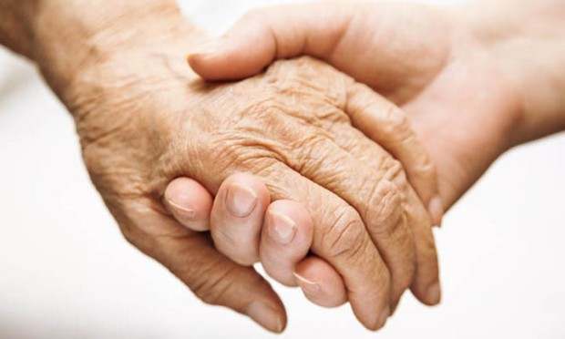 a-young-hand-holding-an-elderly-hand-665-x-400